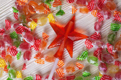 Candy caramel transparent red star on the wooden table white board Royalty Free Stock Image
