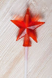 Candy caramel transparent red star on the wooden table white board Stock Images