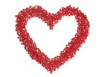 Candy Chip Heart. Red baking chips (cherry) arranged into a hollow heart shape, isoalted on white royalty free stock images