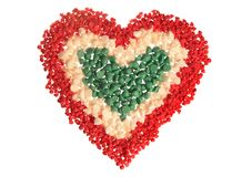 Candy Chip Heart, Tricolor (isolated). Baking chips (cherry, white chocolate, and mint) arranged into a heart shape and isolated on white stock photo