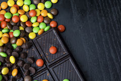 Candy and chocolate bar. Top view of sweet color candy and chocolate bar on the table Stock Images