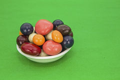 Candy chocolate bowl green background Stock Photos