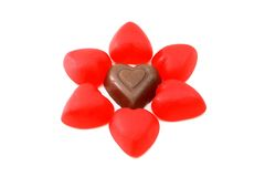Candy and chocolate hearts. Chocolate and red candy hearts royalty free stock photos