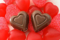 Candy and chocolate hearts. Chocolate and red candy hearts stock photo