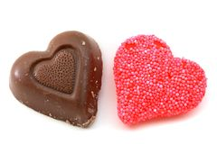 Candy and chocolate hearts. Chocolate and red candy hearts stock image