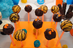 Candy. Chocolate candy on a stick on a stand Stock Photography