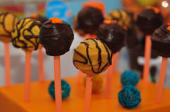 Candy. Chocolate candy on a stick on a stand Royalty Free Stock Images