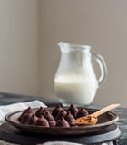Candy chocolate truffles on a plate of dark and cream in a jug, Royalty Free Stock Photos