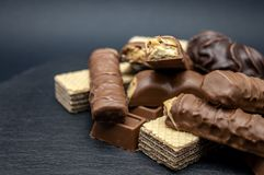 Candy chocolate wafers Brown sweet on black background royalty free stock photography