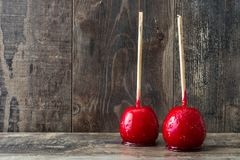 Candy Christmas apples on wood Royalty Free Stock Photography