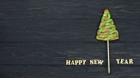 Candy Christmas tree with the letters of a happy new year. On a   background on a holiday new year Stock Photo