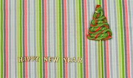 Candy Christmas tree with the letters of a happy new year. On a bright striped background on a holiday new year Stock Images