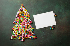 Candy christmas tree shape and greeting card Royalty Free Stock Image