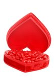 Candy cinnamon hearts in a red heart box Royalty Free Stock Photography