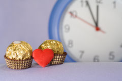Candy and clock Royalty Free Stock Photo