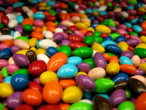 Candy Coated Sunflower Seeds. A collection of brightly colored candy coated sunflower seeds Royalty Free Stock Image