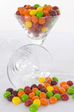 Candy cocktail. Colorful candy in a cocktail glass on a white background Stock Photos