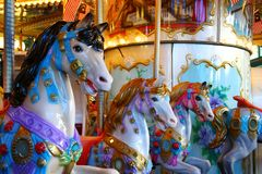 Candy colored carousel horses. In a theme park Royalty Free Stock Photo