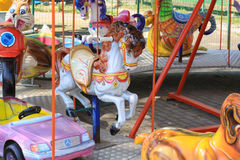 Candy colored carousel. Horses in a theme park Royalty Free Stock Photo