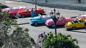 Candy-colored classic american cars, colorful antique cars, aerial view in Havana, Cuba stock photo