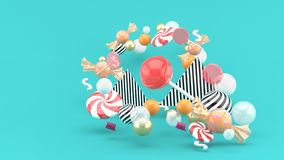 Candy among colorful balls on blue background stock illustration