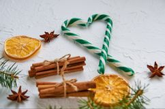 Candy cones with spices - anise stars, dried oranges, cinnamon sticks on the white background with free copy space Royalty Free Stock Images