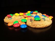 Candy and Cookies. Cookies with colorful candies on top with a black background Royalty Free Stock Photos