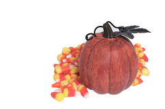 Candy corn. And decorative pumpkin Royalty Free Stock Image