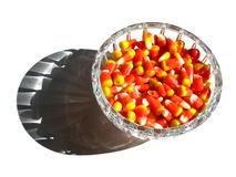 Candy Corn. A crystal dish filled with candy corn sits on a white surface Royalty Free Stock Photography