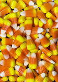 Candy Corn. Background of traditional yellow orange and white candy corn. Candy corn is a confection popular primarily in autumn around Halloween. Candy corn was Royalty Free Stock Photo