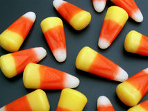 Candy corn. Scattered on black background royalty free stock photo
