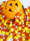 Candy Corn. Candies falling out of Halloween treat bag Stock Photos