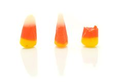 Candy Corn. A macro shot of three pieces of candy corn over a white background Royalty Free Stock Images