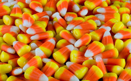 Candy corn alpha. A pile of Halloween candy corn as a background royalty free stock image