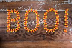 Candy Corn Boo. Spelled on wooden background stock image