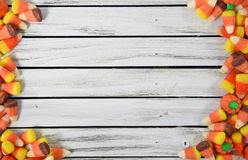Candy corn border on wood Royalty Free Stock Image