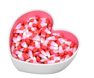 Candy corn in bowl. For Valentine Day royalty free stock photos