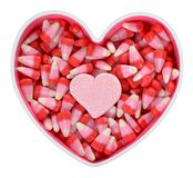 Candy corn in bowl. For Valentine Day stock photography