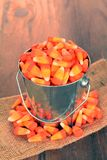 Candy corn. With pail in evening hours for hallow effect stock image
