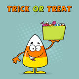 Candy Corn Character Holds A Box With Candy Royalty Free Stock Photos