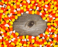 Candy corn in circle border on rustic wooden board Stock Images