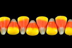 Candy corn delta. Lined up Halloween candy corn stock photo