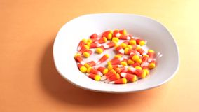 Candy corn filling dish stock footage
