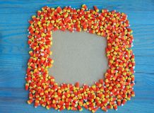 Candy corn frame with green background Stock Images