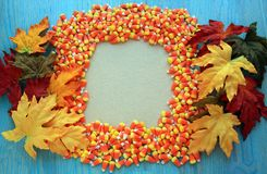 Candy corn frame with leaves Royalty Free Stock Photography