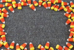 Candy Corn Frame surrounding Tweed Fabric with room or space for text or your words for Halloween or Thanksgiving Stock Photography