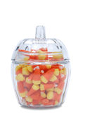 Candy corn, glass dish. Candy corn on a white background Stock Photos