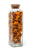 Candy Corn in a Glass Jar. Isolated on White Royalty Free Stock Image