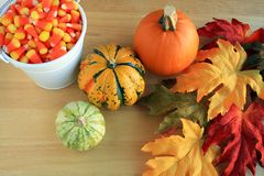 Candy corn gourds and leafs Stock Photography