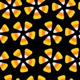 Candy corn. Happy Halloween Seamless Pattern. Round circle flower element.   Stock Images